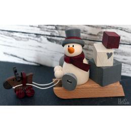 Otto mit Geschenkeschlitten